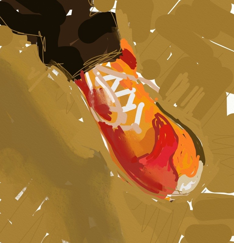 orange and red athletic shoe